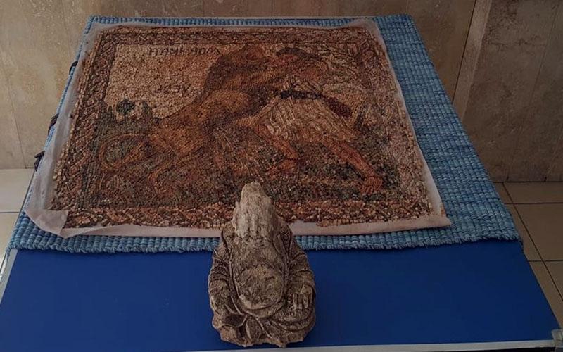 Avcı figürlü mozaik ve buda heykeli ele geçirildi