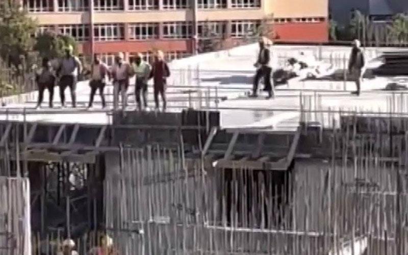 İşçiler inşaatın tepesinde halay çekti
